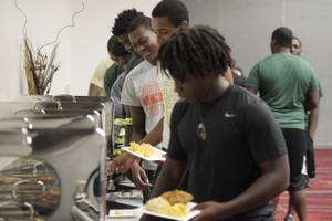 Miami Central High School football players dish up lunch courtesy of Las Vegas Convention Center foodservice contractor Centerplate Wednesday, September 13, 2017. CREDIT: Sam Morris/Las Vegas News Bureau .