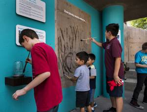 Kids water paint at WaterWorks, Springs Preserve's new permanent exhibit highlighting the inner workings of the valley's water treatment and delivery system, Friday, Sept. 15, 2017.