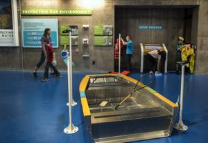 Visitors experience the interactive learning stations at Springs Preserve's new permanent exhibit, Waterworks, which highlights the inner workings of the valley's water treatment and delivery system, Friday, Sept. 15, 2017.