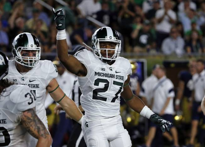 Michigan State safety Khari Willis (27) celebrates a fumble recovery on a punt during the first half of an NCAA college football game against Notre Dame, Saturday, Sept. 17, 2016, in South Bend, Ind.