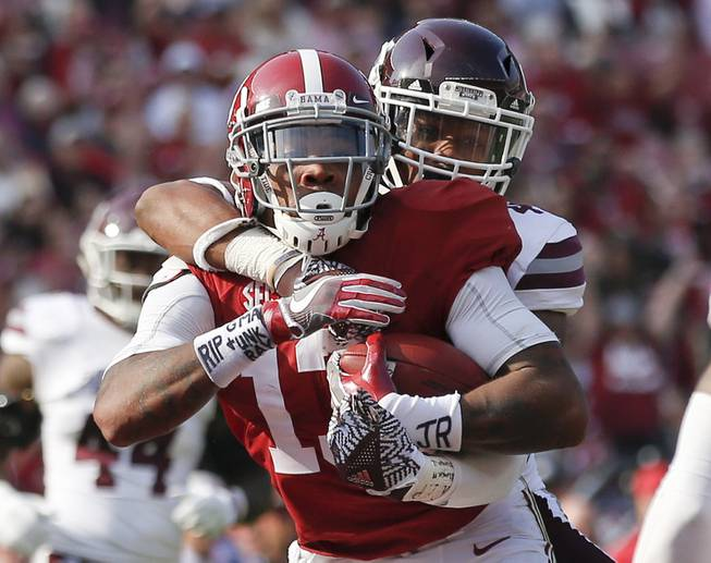 Alabama wide receiver ArDarius Stewart runs into the end zone and scores a touchdown against Mississippi State defensive back Mark McLaurin, during the second half of an NCAA college football game, Saturday, Nov. 12, 2016, in Tuscaloosa, Ala. Alabama won 51-3.