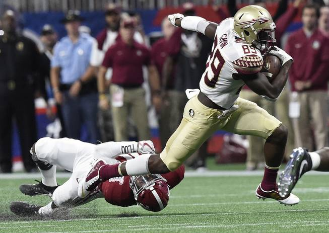 Florida State wide receiver Keith Gavin (89) runs against Alabama linebacker Shaun Dion Hamilton (20) during the first half of an NCAA football game, Saturday, Sept. 2, 2017, in Atlanta.