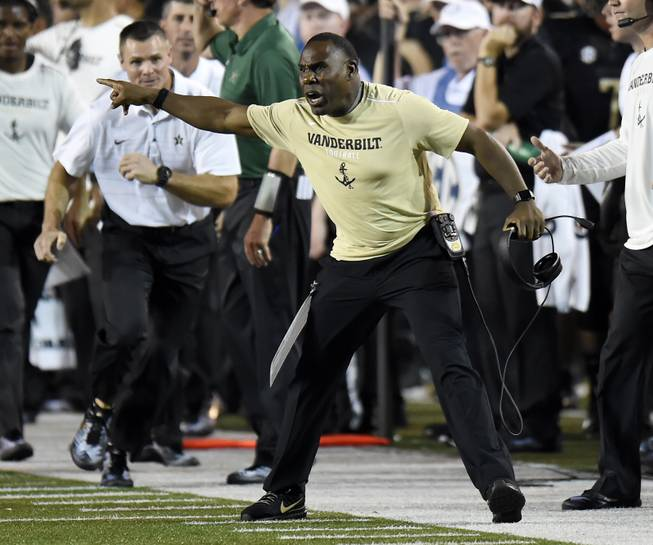 Vanderbilt head coach Derek Mason yells at an official during the first half of an NCAA college football game against Kansas State, Saturday, Sept. 16, 2017, in Nashville, Tenn.