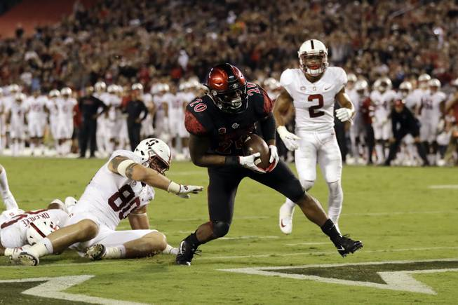 San Diego State running back Rashaad Penny scores a touchdown during the first half of an NCAA college football game against Stanford on Saturday, Sept. 16, 2017, in San Diego. (AP Photo/Gregory Bull)