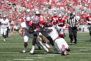 Two UNLV defenders force Ohio State receiver Parris Campbell to fumble in a game on Saturday, Sept. 23, 2017, at Ohio Stadium in Columbus, Ohio. Ohio State defeated UNLV 54-21.
