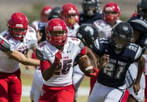 Arbor View's Kyle Graham (25) heads for open territory with Shadow Ridge's Kaejin Smith-Bejgrowicz (21) pursuing during their football game on Saturday, September 23, 2017.