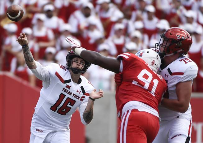 Texas Tech quarterback Nic Shimonek (16) throws a pass over Houston defensive end Nick Thurman (91) during the first half of an NCAA college football game, Saturday, Sept. 23, 2017, in Houston.