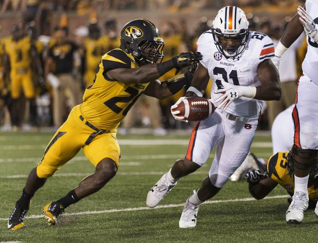 Auburn running back Kerryon Johnson, right, runs past Missouri's Logan Cheadle, left, as he scores a touchdown during the second quarter of an NCAA college football game Saturday, Sept. 23, 2017, in Columbia, Mo.
