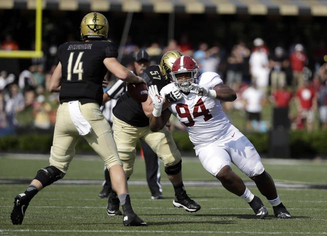 Alabama defensive lineman Da'Ron Payne (94) pressures Vanderbilt quarterback Kyle Shurmur (14) in the first half of an NCAA college football game Saturday, Sept. 23, 2017, in Nashville, Tenn.