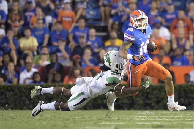 Florida wide receiver Freddie Swain (16) is tackled by North Texas defensive back Ashton Preston (27) after catching a pass during the second half of an NCAA college football game in Gainesville, Fla., Saturday, Sept. 17, 2016.