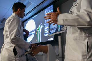 Resident MD Tyler Kent demonstrates how to use the VirtaMed Arthros - a new training device for arthroscopic surgery at UNLV School of Medicine in Las Vegas, Nev. on September 27, 2017.