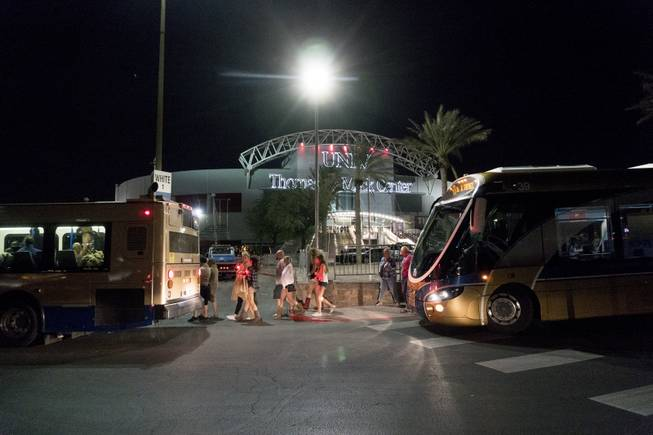 People load into buses destined to different Strip Casinos following a mass shooting at the Route 91 music festival along the Las Vegas Strip, Monday, Oct. 2, 2017. Multiple victims were being transported to hospitals after a shooting late Sunday at a music festival on the Las Vegas Strip. UNLV's Thomas & Mack Center was opened as a place of refuge.