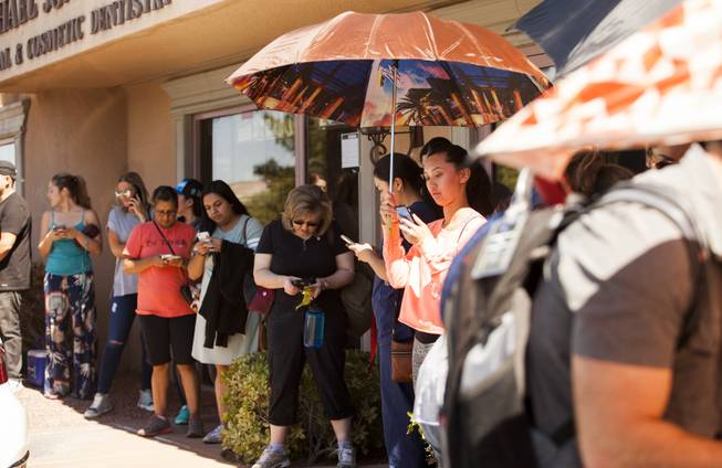 People wait to donate blood at the United Blood Services location on Whitney Ranch Drive, Monday, Oct. 2, 2017, after a mass shooting on the Las Vegas Strip.