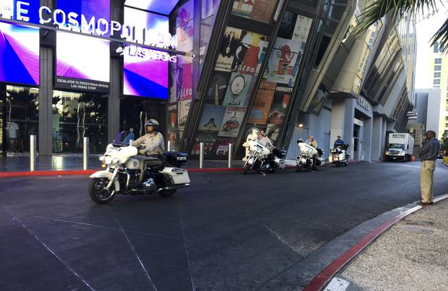 Metro Police Officers guard the Cosmopolitan Hotel and Casino following a mass shooting on the Las Vegas Strip, which left 58 people dead and over 500 injured, Monday, Oct. 2, 2017.
