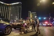 Police officers are shown at the scene of a shooting near Mandalay Bay on the Las Vegas Strip, Sunday, Oct. 1, 2017. Hundreds of victims were transported to hospitals after a shooting late Sunday at a music festival  on the Strip.