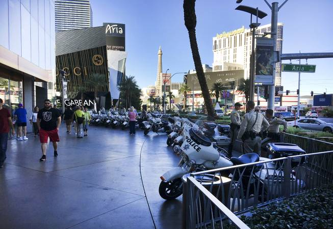 Metro Police lines the sidewalk in front of City Center on the Las Vegas Strip following a mass shooting which left 58 people dead and over 500 injured, Monday, Oct. 2, 2017.
