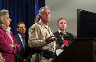 Clark County Sheriff Joe Lombardo, center, responds to a question during a media briefing at the Las Vegas Metro Police headquarters in Las Vegas Tuesday, Oct. 3, 2017.