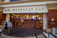MGM Resorts International is laying off workers at Mandalay Bay because of the economic effects of the Oct. 1 shooting ...