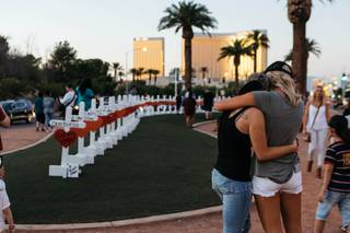 A memorial displaying 58 crosses by Greg Zanis at the Welcome To Las Vegas Sign on October 5, 2017. Each cross has the name of a victim taken during the mass shooting at the Route 91 Harvest festival this past Sunday.