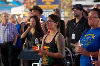 A vigil for the victims in the Route 91 Havest Festival is held during First Friday in Downtown Las Vegas, Friday OCt. 6, 2017.