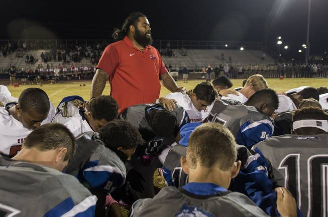 Coronado and Basic players and coaches come together at midfield in a pregame tribute to Charleston Hartfield, the off-duty cop who died during Sundays shooting. His son, Ayzayah Hartfield, plays for Coronado on Friday, October 6, 2017.   .