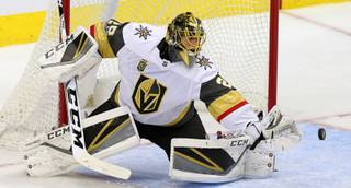 Vegas Golden Knights goalie Marc-Andre Fleury blocks a shot during the first period of an NHL hockey game against the Dallas Stars in Dallas, Friday, Oct. 6, 2017.