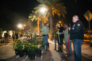 Jay Pleggenkuhle (green shirt, left) and Daniel Perez (green shirt, right) talk to volunteers onsite at a community healing garden being created in response to the Oct. 1 mass shooting, Thursday evening, Oct. 6, 2017. Jay Pleggenkuhle and Daniel Perez of Stonerose Landscapes organized the effort the day after the shooting. Through volunteers and donations, the garden should open on First Friday, five days after the tragic event.