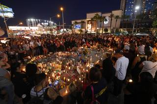 Hundreds of people attend a vigil, marking the one-week anniversary of the Oct. 1 mass shooting, at Sahara Avenue and The Strip Sunday, Oct. 8, 2017.