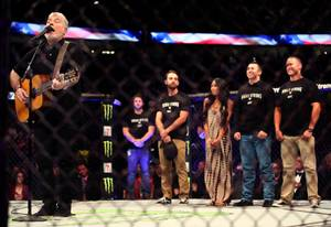 Everest sings a tribute to mass shooting heroesand survivors in the cage behind him during a break in the UFC 216 fights at the T-Mobile Arena on Saturday, October 7, 2017.   .