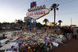 The Welcome to Las Vegas sign is surrounded by flowers ...