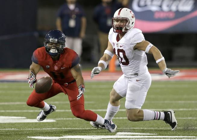 Arizona wide receiver Nate Phillips tries to make the catch in front of Stanford safety Zach Hoffpauir (10) during the first half of an NCAA college football game, Saturday, Oct. 29, 2016, in Tucson, Ariz. The pass was incomplete.