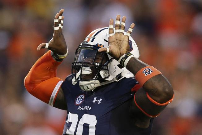 Auburn linebacker Tre' Williams celebrates after a tackle against Georgia Southern in the first half of an NCAA college football game, Saturday, Sept. 2, 2017, in Auburn, Ala.