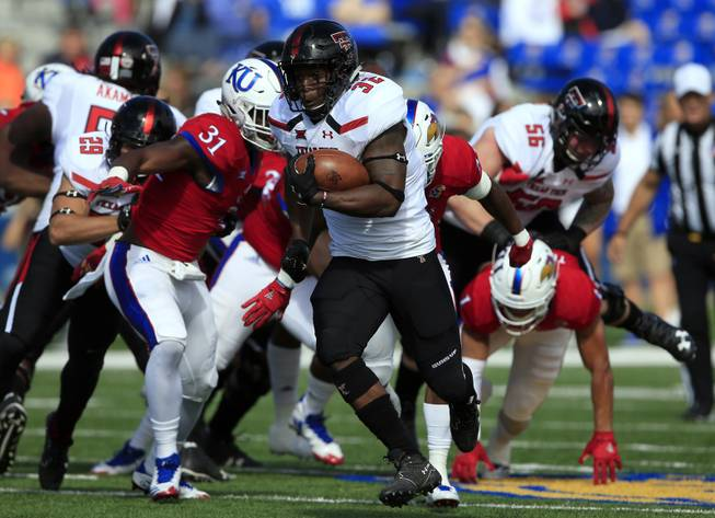 Texas Tech running back Desmond Nisby (32) runs for a 47-yard touchdown during the first half of an NCAA college football game against Kansas in Lawrence, Kan., Saturday, Oct. 7, 2017.