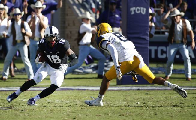 TCU safety Nick Orr (18) intercepts a pass in front of West Virginia wide receiver Marcus Simms (8) during the second half of an NCAA college football game Saturday, Oct. 7, 2017, in Fort Worth, Texas. TCU won 31-24.