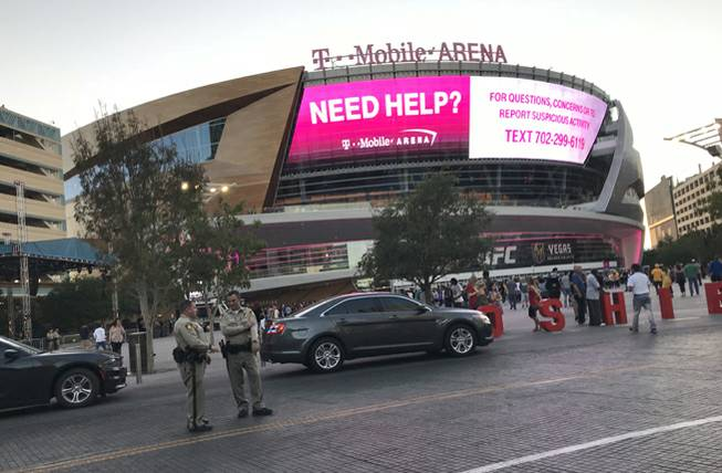 Metro Police officers stand outside T-Mobile Arena on the Las Vegas Strip before the start of the Los Angeles Lakers vs. Sacramento Kings basketball game on Sunday, Oct. 8, 2017.