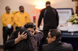 CSC office manager Gina Argento hugs mom Angelica Cervantes at the Davis Funeral Home during a service and burial for Las Vegan Erick Silva, 21, killed in the October 1st mass shooting while working his security job near the stage at Route 91 Harvest festival Thursday, October 12, 2017.
