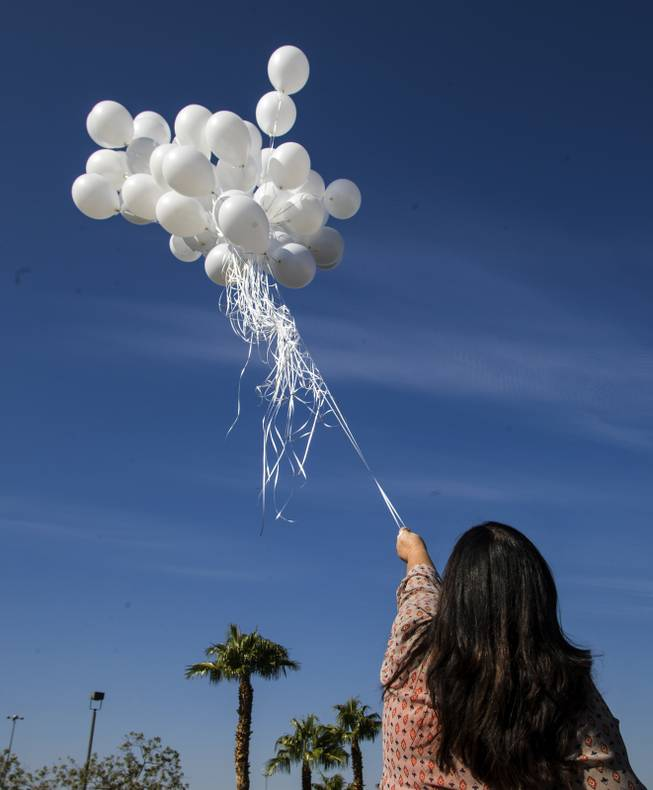 Lisa Schachtel Kodimer is in Las Vegas performing 58 acts of kindness in honor of the mass shooting 58 victims, one a balloon release near Party City Friday, October 13, 2017.