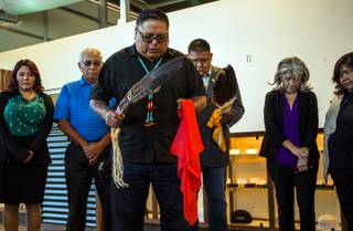 Chris Spotted eagle gives a blessing flanked by the tribal council as the Las Vegas Paiute Tribe opens its Nuwu Cannabis Marketplace for VIP media and politicians for an exclusive look at the mega dispensary before its Monday opening on Saturday, October 14, 2017.