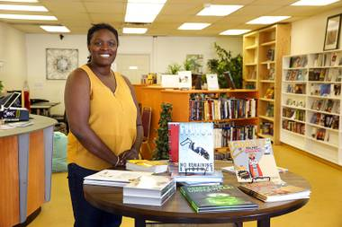 Owner Christina Benton poses in Janco Books, a new and used bookstore at 2202 W Charleston Blvd., Monday, Oct. 16, 2017. The store opened Oct.13.