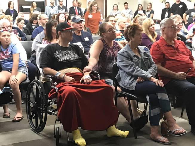Michael Caster and his girlfriend, Tawny Temple, attend a special music set by Michael Ray at Sunrise Hospital on Oct. 11. Caster was shot in the back during the Route 91 Harvest Festival shooting, leaving him paralyzed from the waist down.