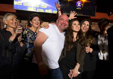 "UFC president Dana White, center, poses with local entertainers and members of the Ellis family during a ""Sing For Strength"" karaoke fundraiser with local entertainers at Ellis Island hotel-casino Tuesday, Oct. 17, 2017. White promised to double the donations raised at the event for victims and families affected by the Oct. 1 mass shooting."