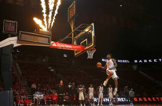 Tervell Beck (14) competes in a dunk contest during the UNLV basketball Scarlet & Gray Showcase at the Thomas & Mack Center in Las Vegas Wednesday, Oct. 18, 2017. STEVE MARCUS