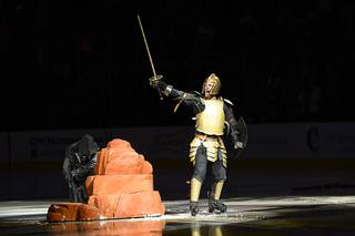 A sword is pulled from a stone as part of the Vegas Golden Knights pregame before taking on the St. Louis Saturday, October 21, 2017, at T-Mobile Arena in Las Vegas. The Knights won the game 3-2 in overtime.