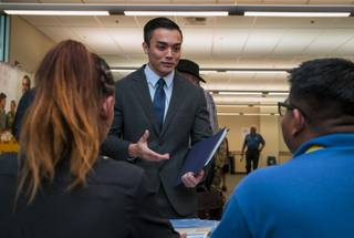 Veteran Cuong Pham speaks with employers from the Bureau of Reclamation during a military veterans job fair at the Vegas PBS campus on Wednesday, Oct. 25, 2017.  Pham recently separated from the U.S. Air Force in July and is currently exploring opportunities.