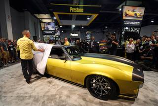 Ring Brothers Mike, left, and Jim Ring, unveil a supercharged 1972 AMC Javelin, created for Prestone's 90th anniversary, during the 2017 Specialty Equipment Market Association (SEMA) show at the Las Vegas Convention Center Tuesday, Oct. 31, 2017.  STEVE MARCUS
