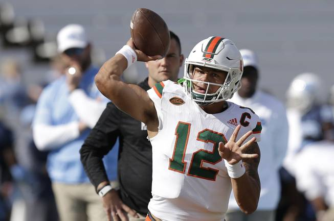 Miami quarterback Malik Rosier (12) passes prior to an NCAA college football game against North Carolina in Chapel Hill, N.C., Saturday, Oct. 28, 2017. (AP Photo/Gerry Broome)