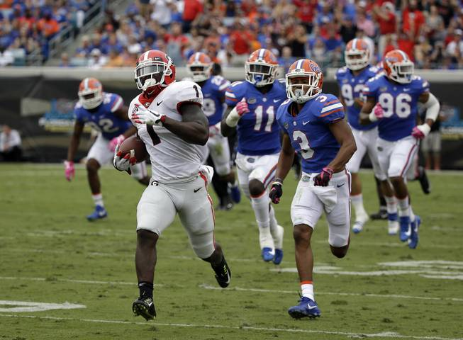 Georgia running back Sony Michel (1) runs a 74-yard touchdown against Florida in the first half of an NCAA college football game, Saturday, Oct. 28, 2017, in Jacksonville, Fla. (AP Photo/John Raoux)
