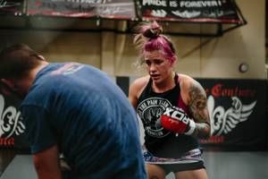 UFC fighter Gina Mazany trains during a sparring practice at Xtreme Couture MMA in Las Vegas, Nev. on October 10, 2017. She recently participated in a brain study with the Cleveland Clinic.
