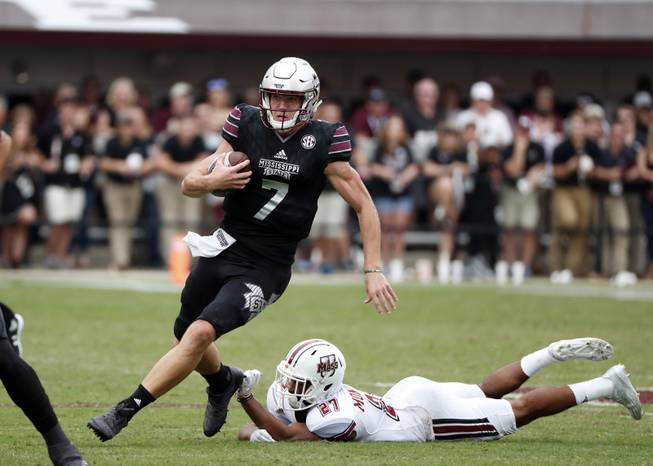 Mississippi State quarterback Nick Fitzgerald (7) runs past Massachusetts defenders in the second half of an NCAA college football game in Starkville, Miss., Saturday, Nov. 4, 2017. No. 21 Mississippi State won 34-23. (AP Photo/Rogelio V. Solis)