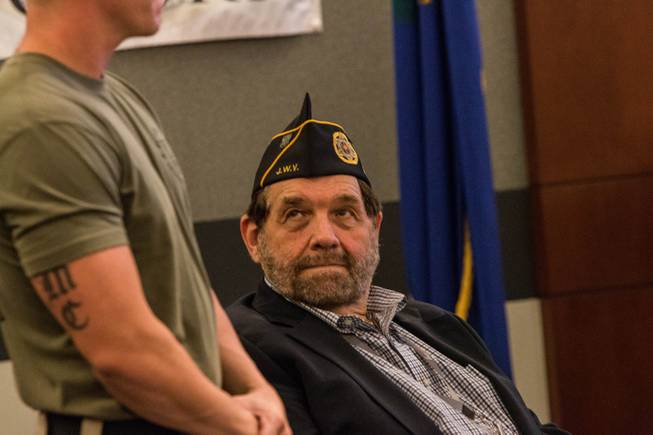 Nevada Supreme Court Chief Justice Michael Cherry, right, looks on as U.S. Marines veteran Erik Georgi, left, is introduced during Veterans Treatment Court graduation ceremony on Oct. 25, 2017. Georgi was presented a certificate for his advancement in the program.